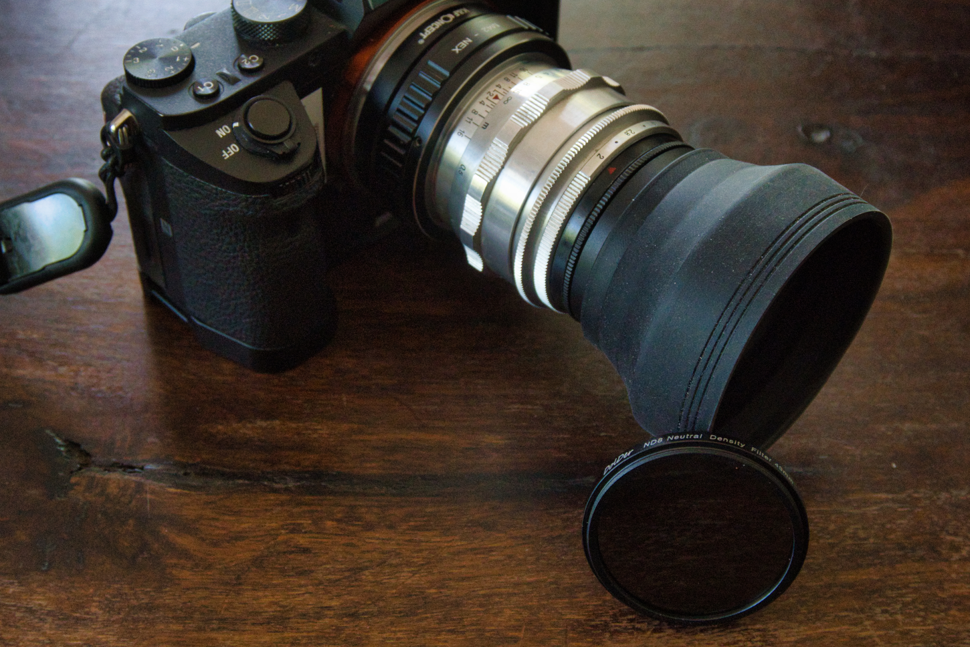 Carl Zeiss Biotar 58 f2 with ND8 grey filter and lens hood